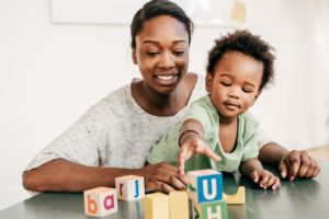 Mom and son playing with blocks at table