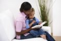 Toddler and mother reading a story together