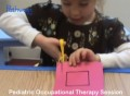 Girl cutting during occupational therapy session