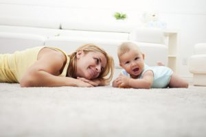 iStock_000027979590Large-mother-and-baby-playing-in-white-livingroom