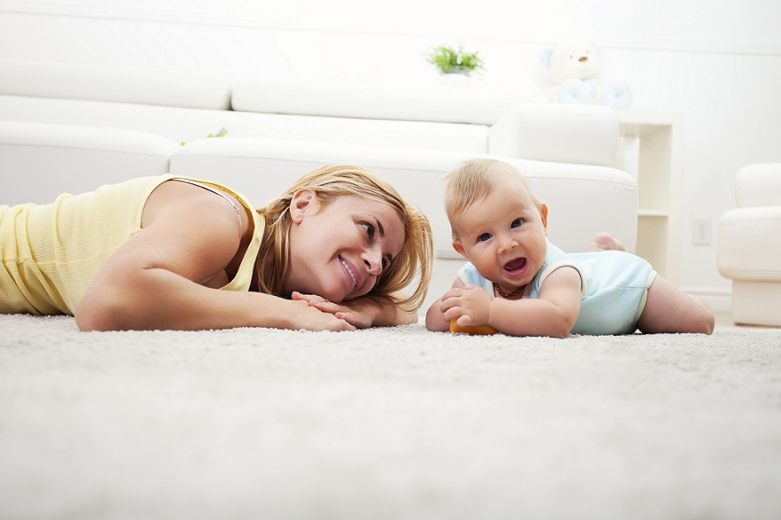 mom and baby playing on living room floor