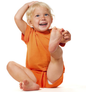 portrait of funny stretching little girl