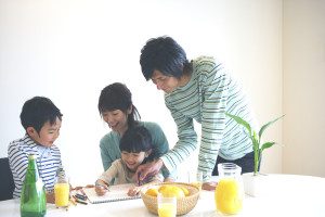 Family relaxing in dining room