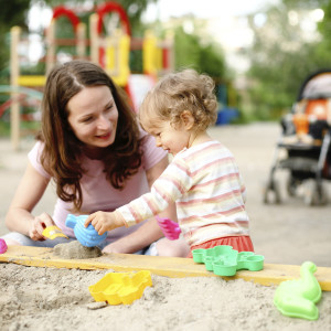 mom_and_daughter_playing_with_toys_in_sand