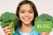 blog post about eating veggies - young girl holding broccoli