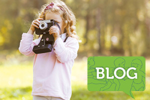 young_girl_with_camera_outside_in_fall_BLOGicon