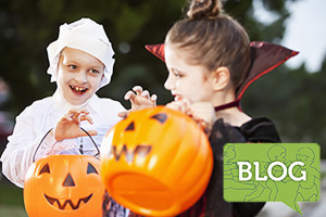 Children in halloween costumes going trick-or-treating