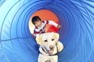 boy_in_tunnel_with_dog_400px