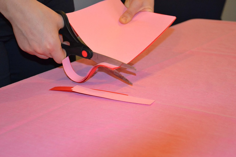 Cutting strips on construction paper