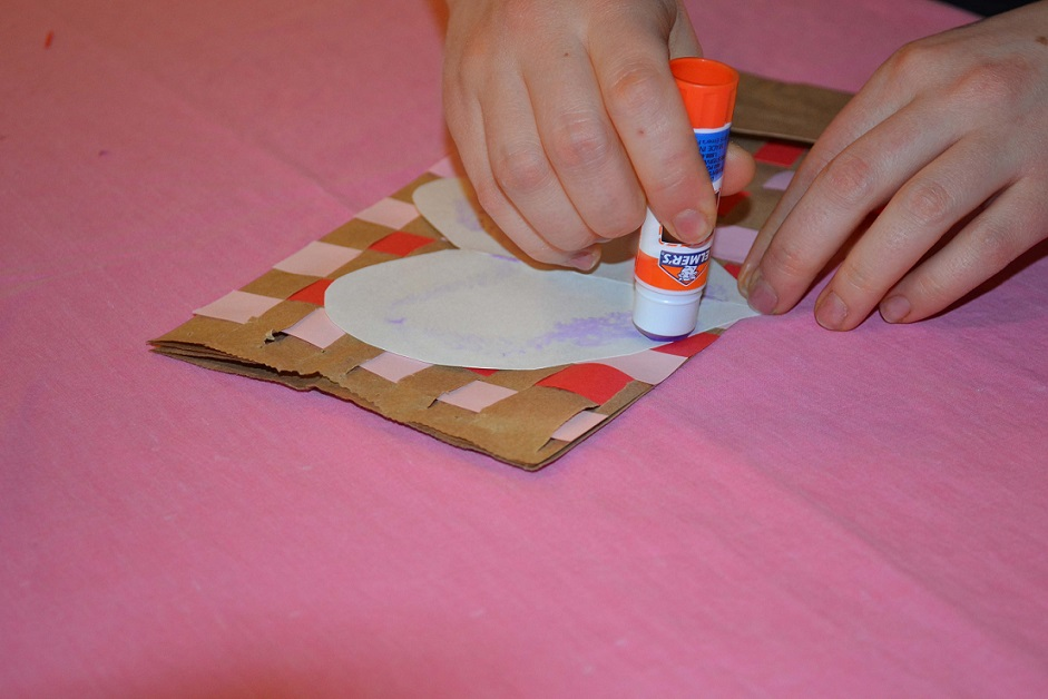 using a glue stick during valentine's day craft