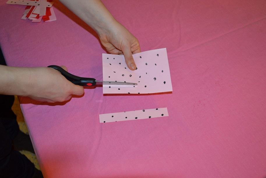 cutting polka dot paper