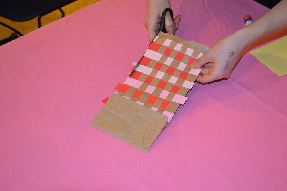 cutting fine motor skills - trimming edges of paper