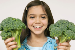 young_girl_holding_broccoli