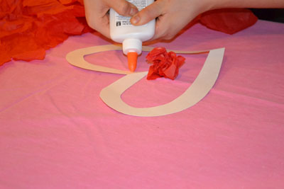 using glue during valentine's day craft for kids
