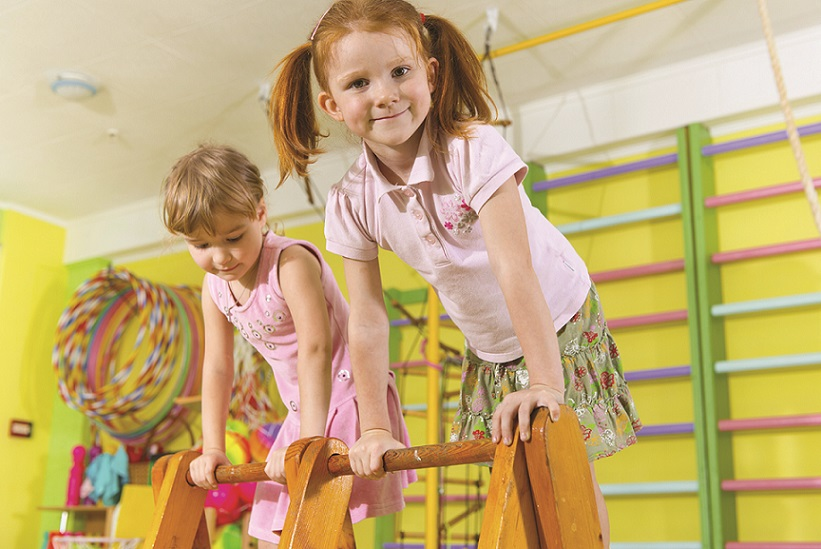 Cute children climbing in gym