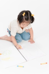 little_girl_w_sitting_while_coloring_smaller