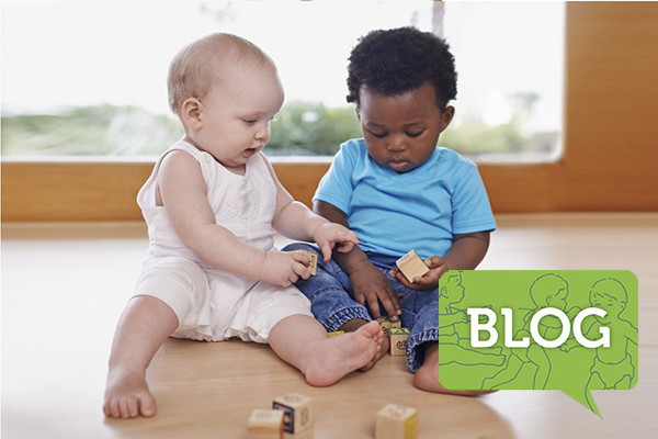 two_babies_black_and_white_playing_blocks