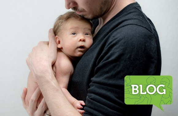 man holding newborn baby