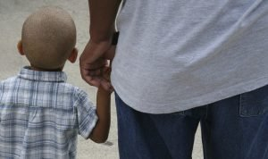 little_boy_holding_dads_hand