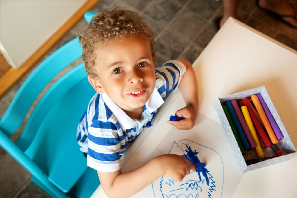 preschooler_playing_with_a_box_of_crayons