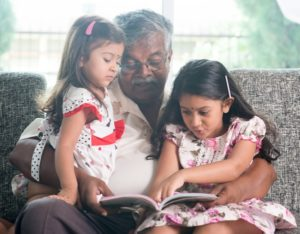 indian_kids_grandpa_reading_book_together