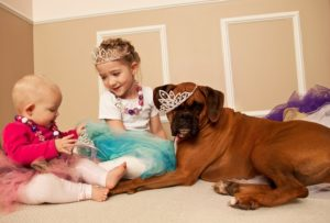 two girls with dog playing dress up