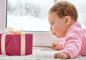 baby_girl_looking_at_present