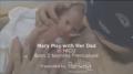 Dad holding premature baby in NICU