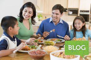 family of four having dinner together