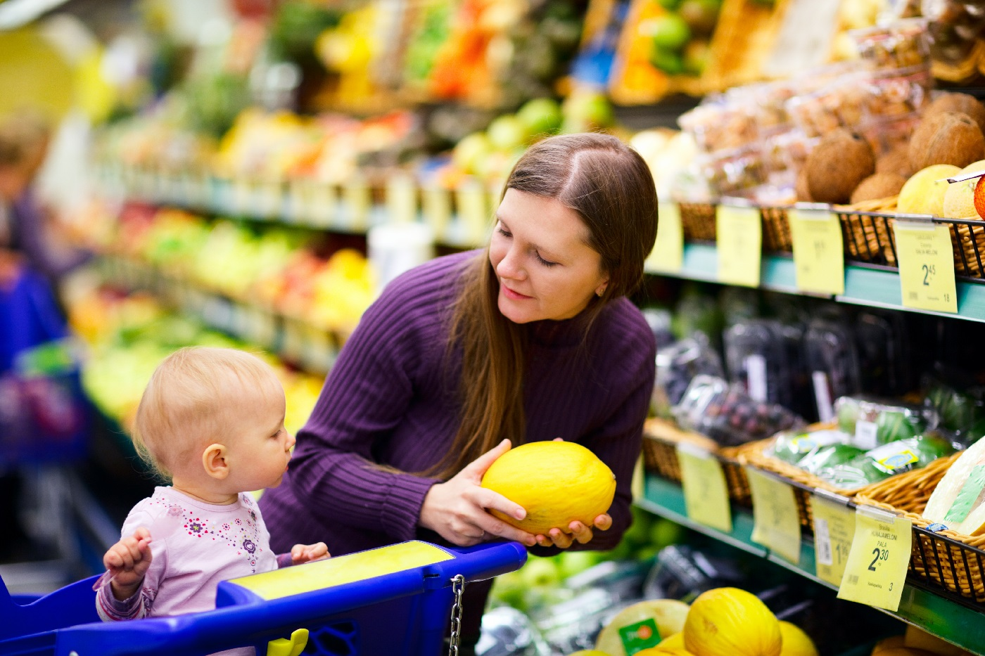 Mom and daughter shopping at grocery store together