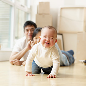 parent's watching baby crawl in new house