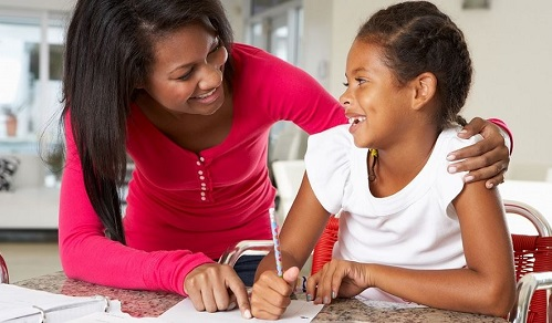 mom and daughter working on homework