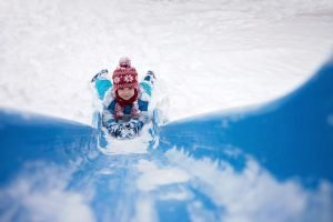 boy_going_down_snowy_slide