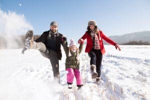 family_kicking_snow