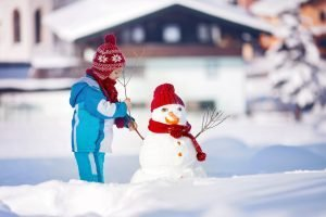 young_child_building_snowman