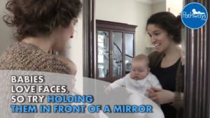 baby playing with mirror