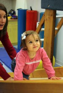 little_girl_climbing_up_slide
