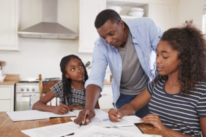 Father_Helping_Two_Daughters_With_Homework