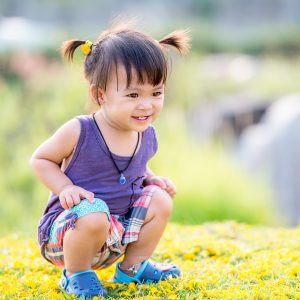 little_girl_with_pigtails_in_grass