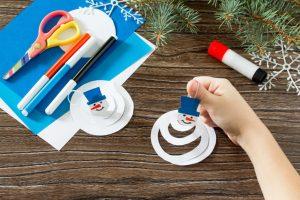 child_making_snowman_craft