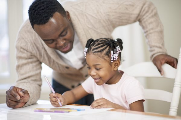 dad and daughter doing homework