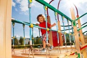 kid_running_across_playground_bridge