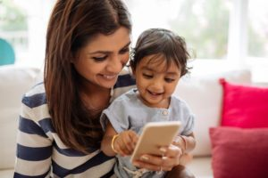 mom and boy playing on phone