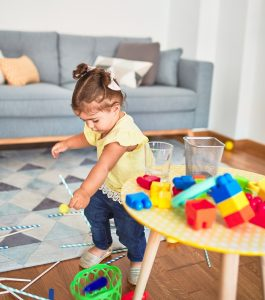 toddler_with_straws_in_living_room