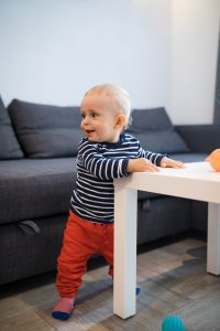 baby_holding_onto_table
