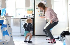 mom_and_toddler_dancing_in_kitchen
