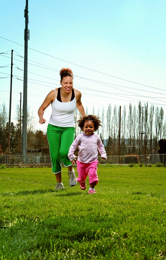 Mother-and-Daughter-Running-Through-Park