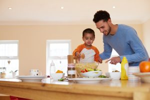 father_and_son_working_together_in_kitchen